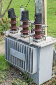 foto of transformer  - Close up of electricity transformers up in power line post against blue sky - JPG