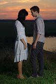 Couple at sunset and lake