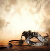 stock photo of mask  - venetian mask with glittering background and copyspace - JPG