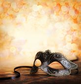 stock photo of mask  - venetian mask with glittering background and copy space - JPG