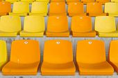 picture of grandstand  - Yellow and Orange Empty Seats of a Grandstand - JPG