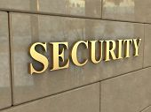 stock photo of chisel  - The word Security is chiseled by gold letters on a stone wall - JPG