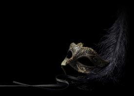 stock photo of venice carnival  - golden carnival mask isolated on black background - JPG
