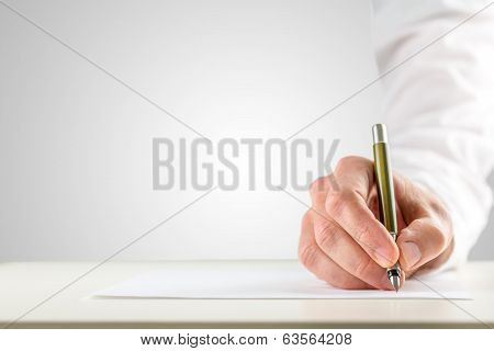 Hand Holding A Ballpoint In Order To Start Writing poster