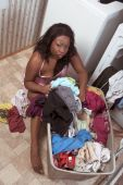 African American Woman By Basket Of Dirty Laundry