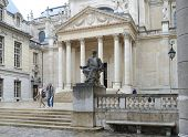 PARIS, FRANCE - SEPTEMBER 14, 2013: Monument to Louis Pasteur against the Chapelle de la Sorbonne. I