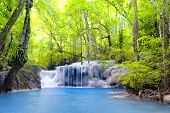 stock photo of emerald  - Waterfall in tropical forest nature landscape background - JPG