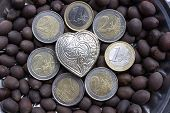 collection of EURO coins around a heart shaped JEWEL silver box