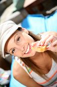 Portrait of cheerful girl in Spain eating finger food