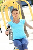 Fitness girl exercising with outdoors sports facilities