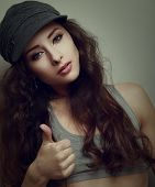 Trendy Hiphop Style Girl Showing Thumb Up. Closeup Vintage Portrait