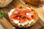 stock photo of bagel  - Homemade Bagel and Lox with Cream Cheese Capes and Dill - JPG