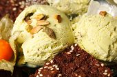 Pistachio ice cream topped with nuts
