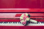 bridal bouquet and red piano,  close-up
