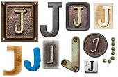 Alphabet made of wood, metal, plasticine. Letter J