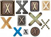 Alphabet made of wood, metal, plasticine. Letter X