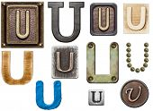 Alphabet made of wood, metal, plasticine. Letter U