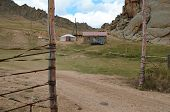 picture of yurt  - Mongolian yurt and small house near the mountains - JPG
