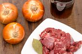 stock photo of deer meat  - Condiments onions and stock for venison of deer - JPG