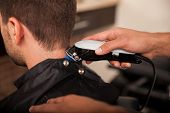 picture of clippers  - Closeup of a barber using hair clippers on a customer