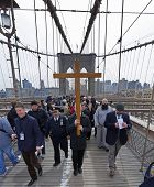 Jonathan Fromm with cross on Brooklyn Bridge