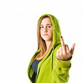 Serious Girl Making Horn Gesture Over White Background