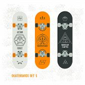 Set Of Retro Vintage Badges On A Skateboard
