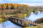 Autumn Landscape With River And Wooden Bridge