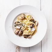 Seafood Pasta With Clams Spaghetti Alle Vongole On White Wooden Background