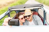 Happy Couple Taking A Selfie On A Vintage Car