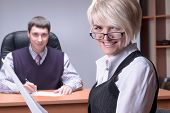 Young and smiling business lady in office