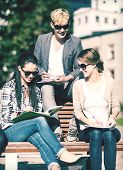 summer holidays, education, campus and teenage concept - group of students or teenagers with books,
