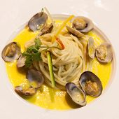 Spaghetti With Clams And Sauce In A Dish