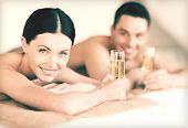 stock photo of all-inclusive  - picture of couple in spa salon drinking champagne - JPG