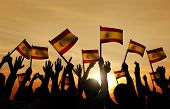 Silhouettes of People Holding Flag of Spain