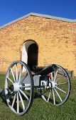 stock photo of cannon  - Cannon sits outside the 1816 built arsenal in Fort Mifflin. Pointing North, the cannon was from the Civil War.