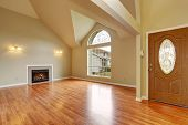 Empty Living Room With Fireplace Nd Big Arch Window