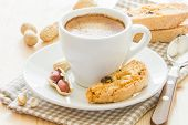 stock photo of baked raisin cookies  - Cup of coffee and biscotti with peanut and raisins - JPG