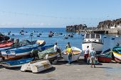 Harbor With Fishermen And Fishing Ships At Funchal, Portugal
