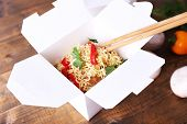 pic of chinese parsley  - Chinese noodles in takeaway boxes with mushrooms and parsley on wooden background - JPG