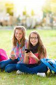 Teen Schoolgirls Having Fun With Mobile Phone