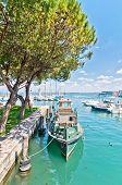 Harbor With Boat In Desenzano On Lake Garda, Italy