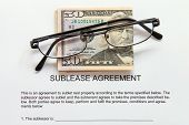 Sublease agreement with dollars and glasses