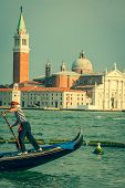 Venice, Italy,august 9, 2013: Traditional Gondola On Canal Grande With San Giorgio Maggiore Church