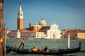 Venice, Italy,august 9, 2013: Traditional Gondola On Canal Grande With San Giorgio Maggiore Church