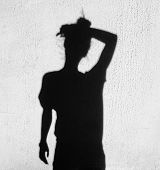 Shadow Of A Tired Woman Wiping Forehead