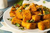 stock photo of butternut  - Organic Baked Butternut Squash with Herbs and Spices - JPG