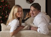 Young Couple Celebrating Christmas Together