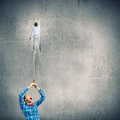Girl holding on lead businessman. Business competition