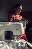 Seamstress Woman During Work